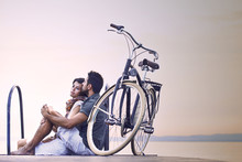 Couple In Love Resting On A Bo...