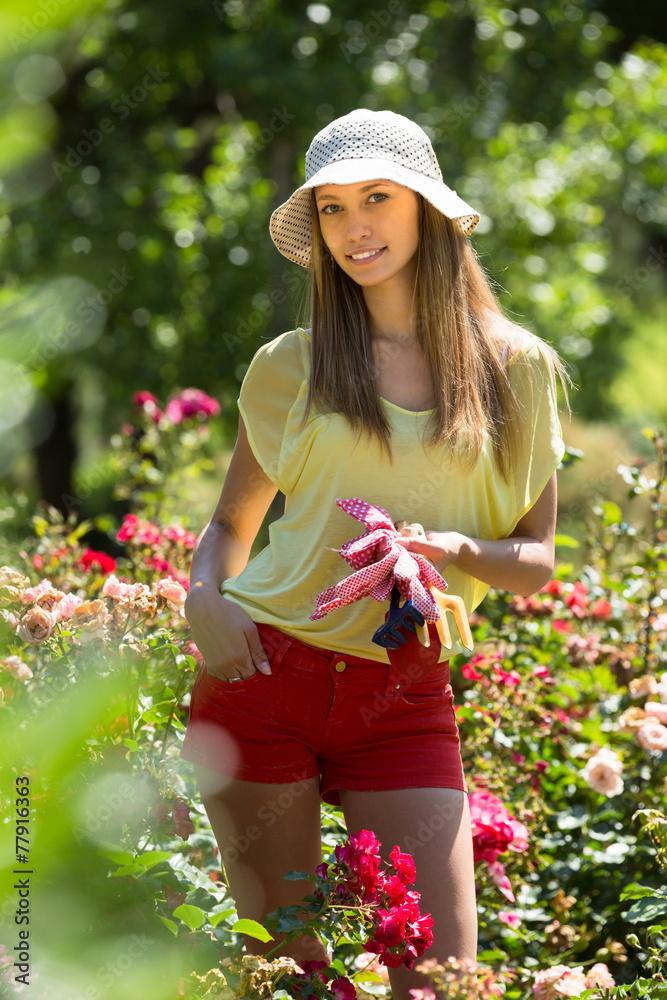 Fototapety, obrazy: Female florist working in garden
