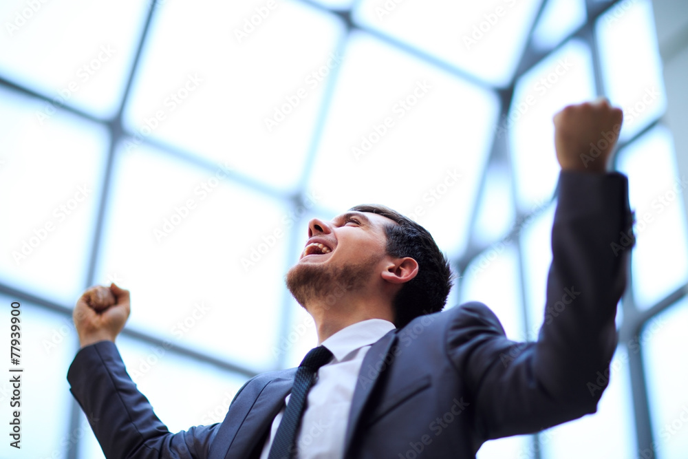 Fototapeta businessman with arms up celebrating his victory