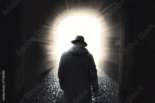 Old man getting out from dark Canvas Print