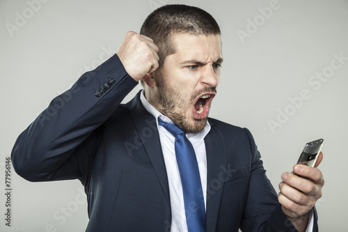 Fototapety, obrazy: businessman talking on the phone and asks for silence