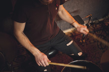 Young Drummer Playing At Drums Set