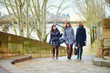 Three cheerful girls walking together in Paris
