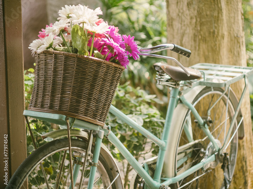Fotobehang Retro Vintage bicycle with flowers in basket