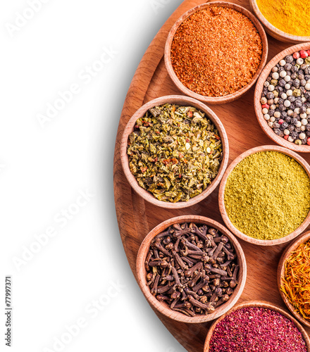 Foto op Aluminium Kruiden assorted spices in a wooden bowl