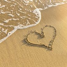 Heart Drawn In Beach Sand, Gentle Surf Wave.
