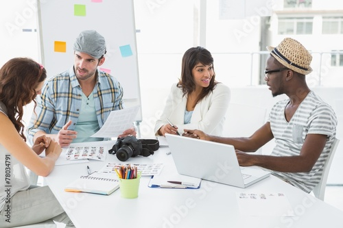 Fototapety, obrazy: Smiling colleagues sitting at desk interacting