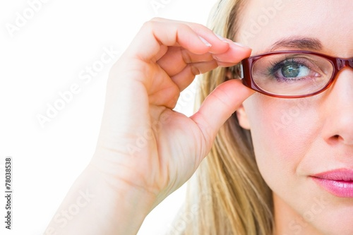 Fotografía  Close up of pretty blonde with red reading glasses