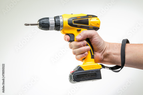 electric screwdriver in his hand