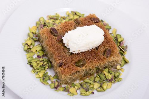Fotografie, Obraz  kadayıf dessert with milk cream and pistachio