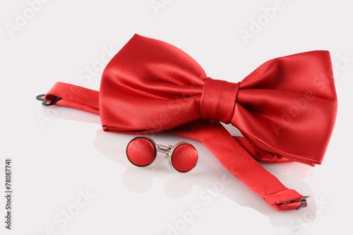 Photo red bow tie  with cuff links on white background