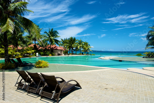 Fototapeta Swimming pool vacation resort with recliner in Boracay obraz
