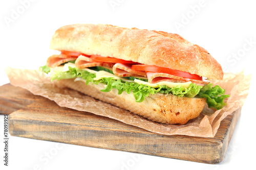 Staande foto Snack Fresh sandwich on wooden cutting board isolated on white