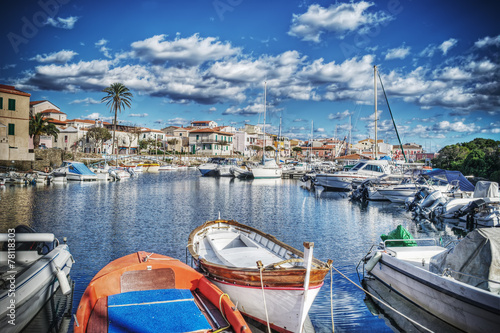 Photo  wooden boats in Stintino harbor in hdr