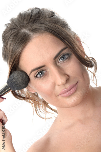 Valokuva  Attractive Young Woman Applying Make Up