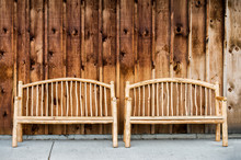 Two Rustic Wooden Log Benches