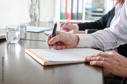 Foto  Geschäftsleute, Notizen
