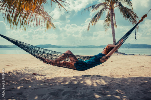 Poster  Woman relaxing in hammock on tropical beach