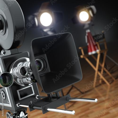 Video, movie, cinema concept. Retro camera, flash and director's Canvas Print