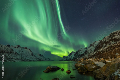 Photo sur Toile Bestsellers Aurora Borealis reflected between two fjords in Tromsø