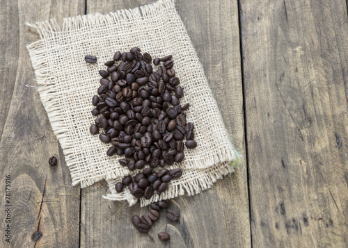 Wall Murals Coffee beans coffee beans on the wooden table