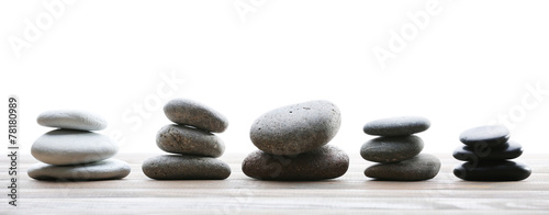 Photo  Spa stones on table on light background