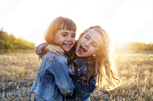 Fotografie, Obraz  Two young girls have fun outside