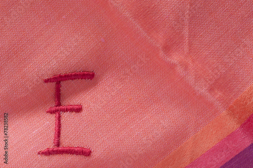 letter E embroidered on a handkerchief Wallpaper Mural