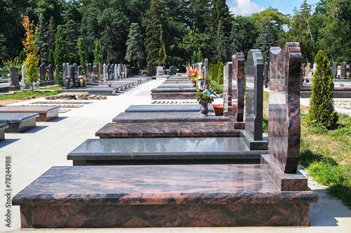 Foto op Canvas Begraafplaats Tombstones in the cemetery