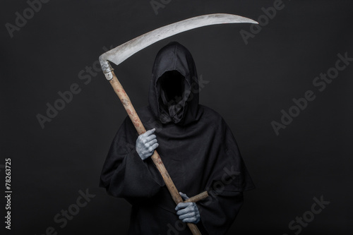 Photo  Death reaper over black background. Halloween