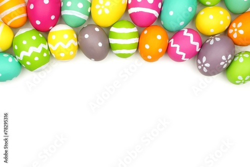 Photo  Colorful Easter egg top border against white