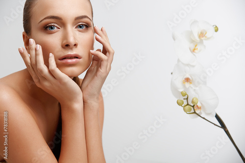 Fotografie, Obraz  Spa Woman. Beautiful Girl Touching Her Face. Perfect Skin.