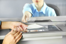 Teller Window With Working Cashier. Concept Of Payment Of