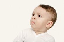 Cute Baby Boy Looking Up Upset. Baby Looking Disgusted.