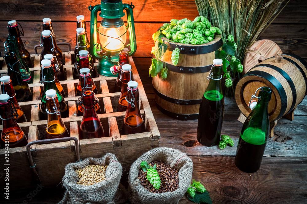 Fototapeta Ingredients for beer and bottles in the cellar