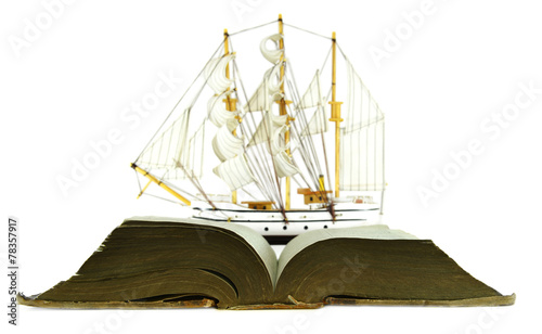 Sailing ship and open book with blue pages