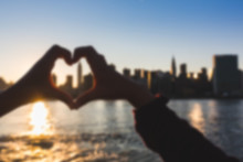 Heart Shaped Hands With New York Skyline. Blurred Background.