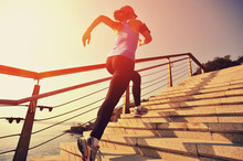 Young Fitness Woman Running On...