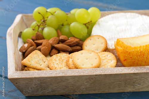 Staande foto Zuivelproducten cookies with cheese, grapes