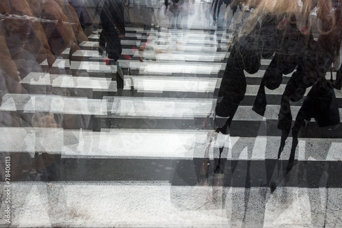 People crossing a road, blurred, in motion Canvas Print