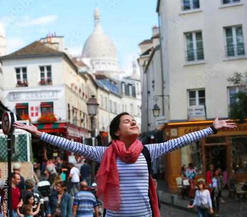 Happy beautiful girl on Montmartre in Paris Wallpaper Mural