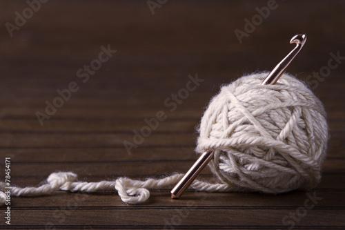 Fototapeta Ball of cream yarn with crochet hook