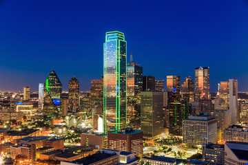 Fototapeta Wieżowce Dallas, Texas cityscape with blue sky at sunset