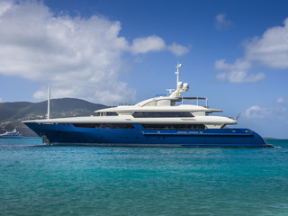 Fototapeta na wymiar A large private motor yacht under way out at sea