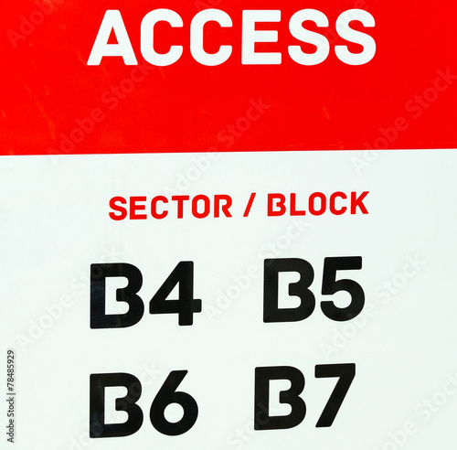 Fotografiet  Access sign at the entrance of the sport stadium