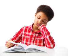 African American School Boy Reading Book Without Interest