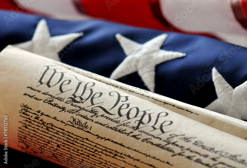 Fotografering We The People - U.S. Constitution document and flag