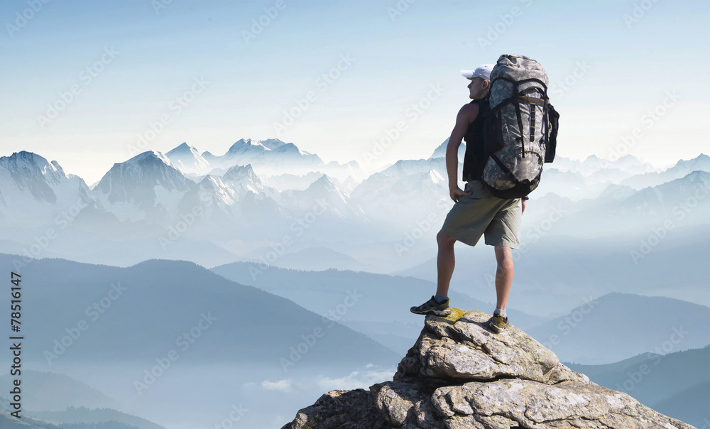 Fototapety, obrazy: Tourist in mountain peak. Active life concept