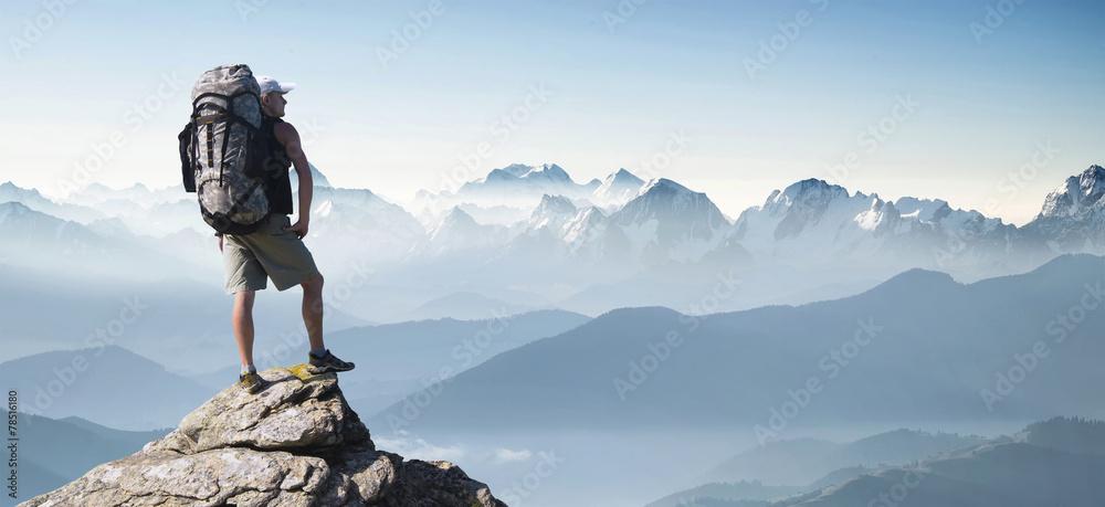 Fototapety, obrazy: Tourist in mountain peak. Active life concept