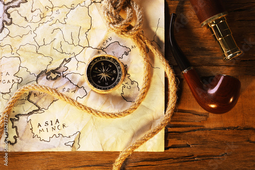 Marine still life with world map and rope #78527372